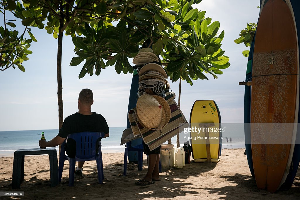 A tourist holds a bottle of beer at Kuta Beach on April 16, 2015 in Kuta, Bali, Indonesia. Indonesia, on April 16, banned small retailers from selling beer which is proposed that legislation by two Islamic parties-the Prosperous Justice Party and the United Development Party-that would ban all consumption of alcoholic drinks and bring jail terms of up to two years for offenders in Indonesia, home to the world's largest Muslim population. The regulation states that it is needed to protect public morals and culture and to improve the control and supervision of alcohol production, distribution and sales. There had been particular anxiety about how the ban might affect tourism on the Hindu-majority resort island of Bali. However, Indonesian trade minister Rachmat Gobel, who was shouted at during an ill-tempered meeting with community leaders in Bali last weekend, has now pledged to ease the restrictions on the island to ensure street vendors can still sell beer at the beach.