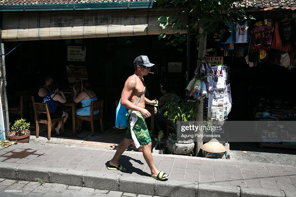 A tourist holds a bottle of Bintang beer as he walks through Popies Lane II Street on April 16, 2015 in Kuta, Bali, Indonesia. Indonesia, on April 16, banned small retailers from selling beer which is proposed that legislation by two Islamic parties-the Prosperous Justice Party and the United Development Party-that would ban all consumption of alcoholic drinks and bring jail terms of up to two years for offenders in Indonesia, home to the world's largest Muslim population. The regulation states that it is needed to protect public morals and culture and to improve the control and supervision of alcohol production, distribution and sales. There had been particular anxiety about how the ban might affect tourism on the Hindu-majority resort island of Bali. However, Indonesian trade minister Rachmat Gobel, who was shouted at during an ill-tempered meeting with community leaders in Bali last weekend, has now pledged to ease the restrictions on the island to ensure street vendors can still sell beer at the beach.