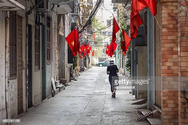 Tourist in a street  with flags and cables