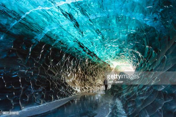 Tourist in Crystal Ice Cave, Iceland