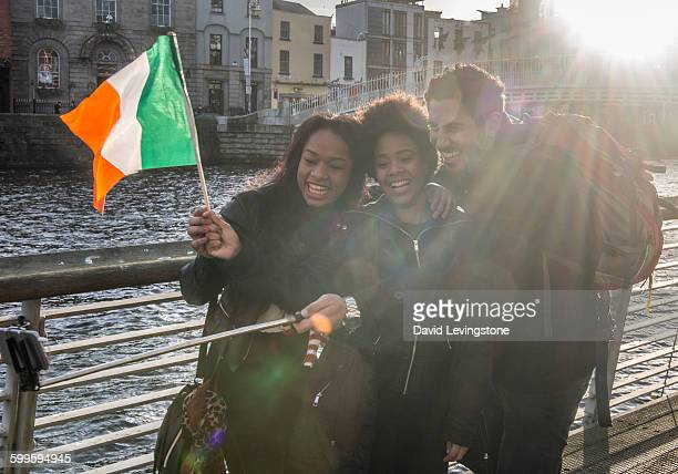 tourist in dublin city centre - irish flag stock pictures, royalty-free photos & images