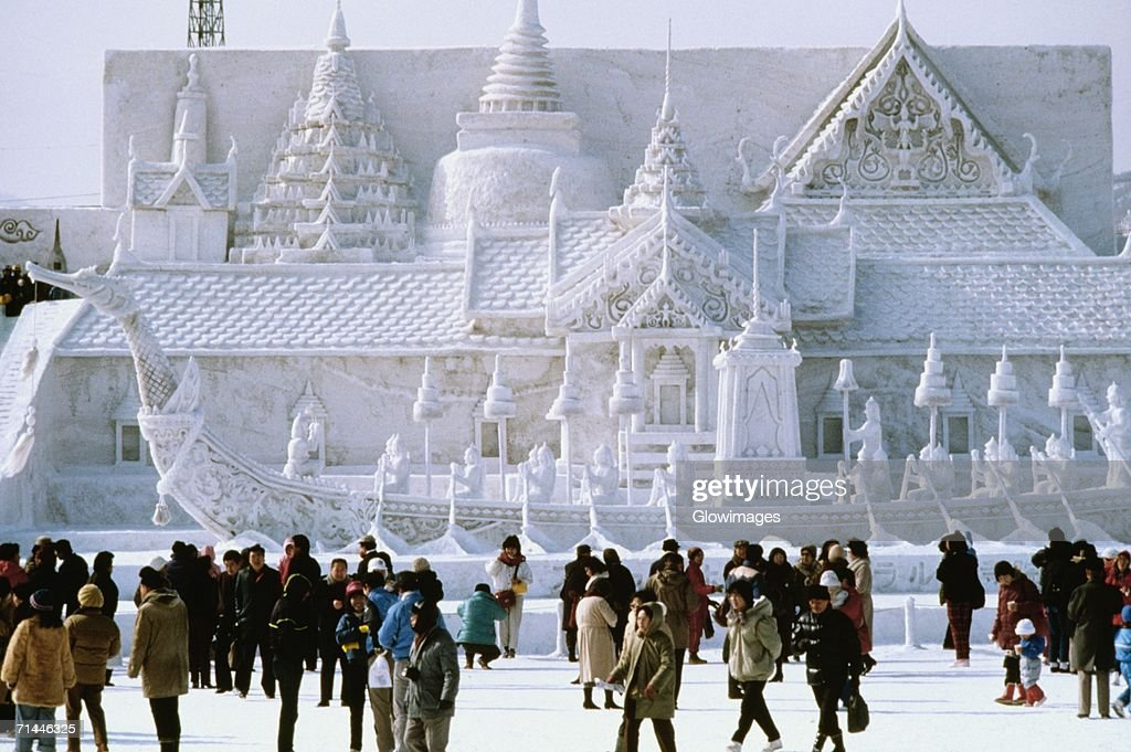 Tourist in front of a snow sculpture, Bangkok's Royal Palace, Snow Festival, Sapporo, Japan : Stock Photo