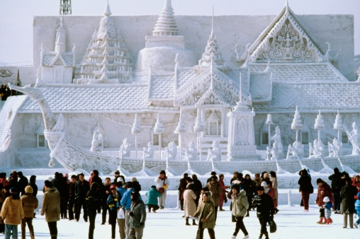 Tourist in front of a snow sculpture, Bangkok's Royal Palace, Snow Festival, Sapporo, Japan - gettyimageskorea