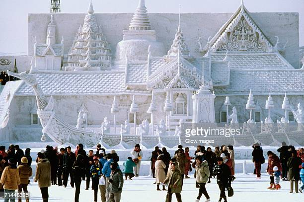 tourist in front of a snow sculpture, bangkok's royal palace, snow festival, sapporo, japan - snow festival stock pictures, royalty-free photos & images