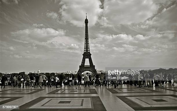 Tourist In Front Of Eiffel Tower