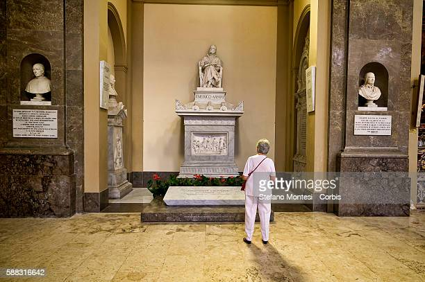 Tourist in front of the tomb of the judge Giovanni Falcone killed by the mafia in the Basilica of San Domenico the pantheon of illustrious Sicilians...