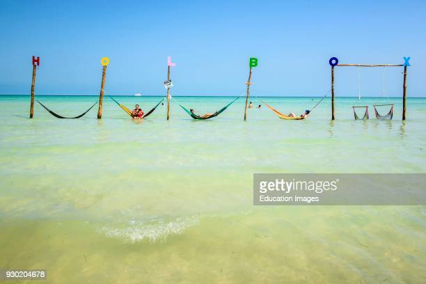 Tourist in hammocks on a beach in Isla Holbox Quintana Roo Mexico