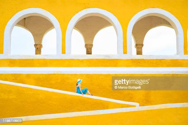 tourist in izamal, yucatan, mexico - wide shot stock pictures, royalty-free photos & images