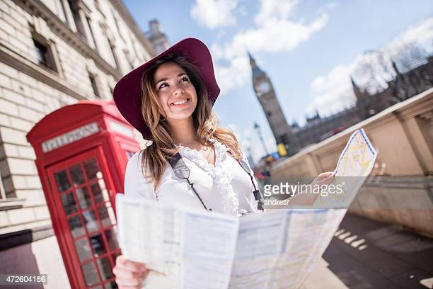 Tourist in London holding a map