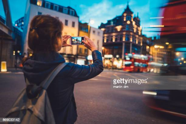 tourist in london taking photos - rear view photos stock photos and pictures