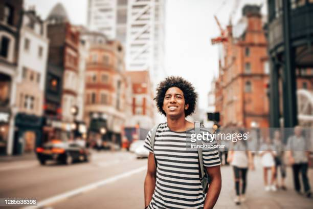 tourist in london using the phone - standing stock pictures, royalty-free photos & images