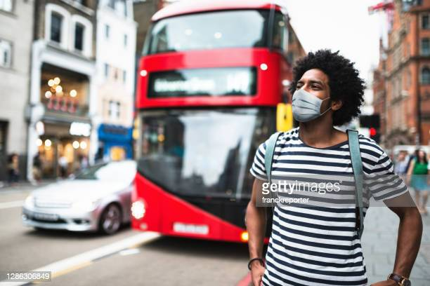 tourist in london using the phone - london stock pictures, royalty-free photos & images