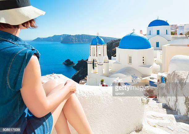 Tourist in Oia on Santorini island, Greece