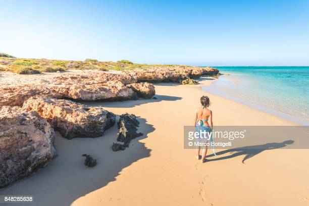 tourist in osprey bay. exmouth, western australia - western australia stock pictures, royalty-free photos & images