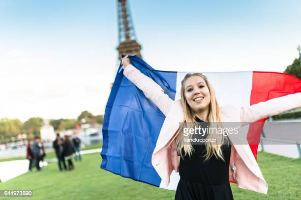 tourist in paris with a french flag