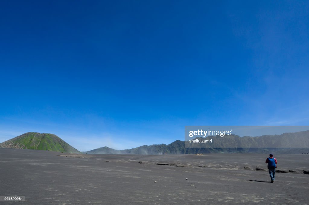 Tourist in savanna of Tengger caldera at Mt. Bromo, East Java, Indonesia. : Stock Photo