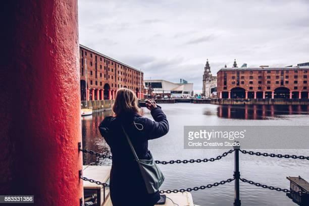 Tourist in the Albert Dock, Liverpool