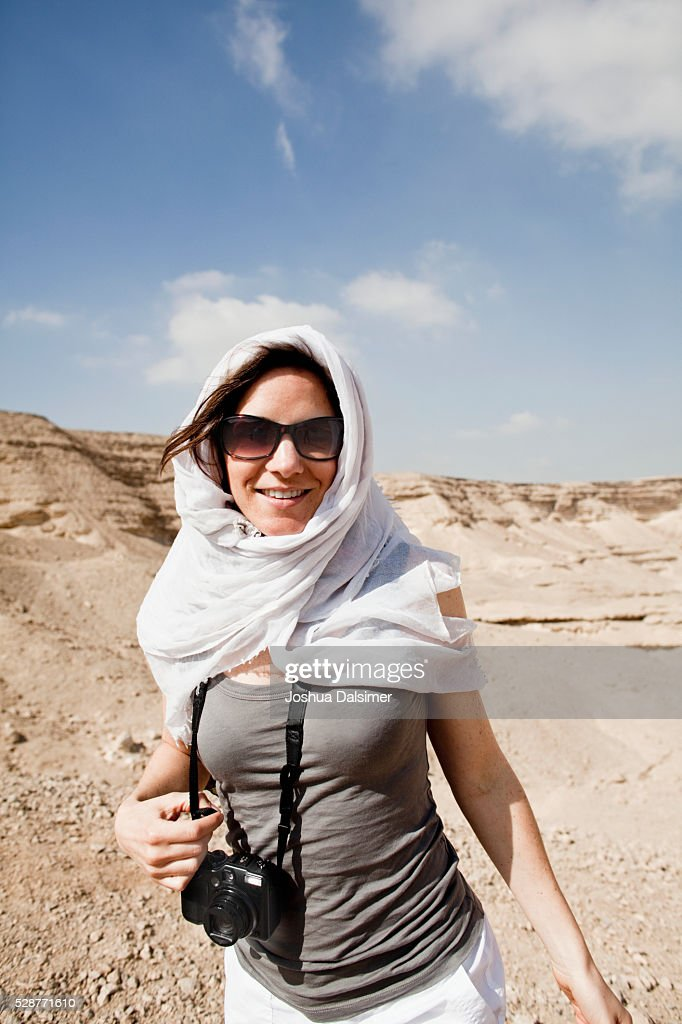 Tourist in the desert : Stock Photo