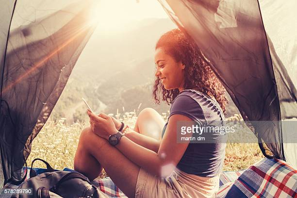 Tourist in the mountain text messaging