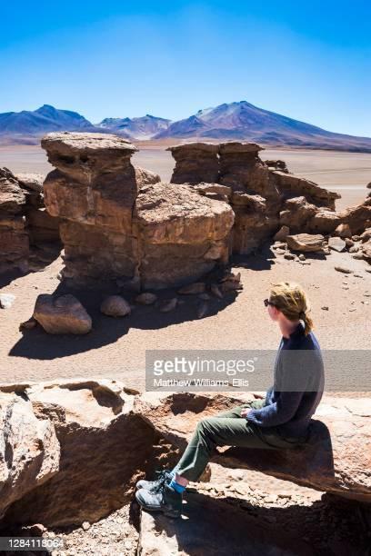 Tourist in the Siloli Desert, part of Atacama Desert, in the Altiplano of Bolivia, Eduardo Avaroa Andean Fauna National Reserve, South America.