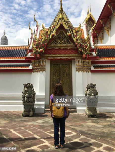 Tourist in Wat Pho temple in Bangkok, Thailand