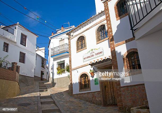 Tourist information building and alleyways in the Andalusian village of Comares Malaga province Spain