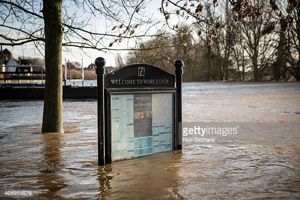 A tourist information sign is surrounded by flood water on February 12 2014 in Worcester England The Environment Agency has issued flood warnings for...