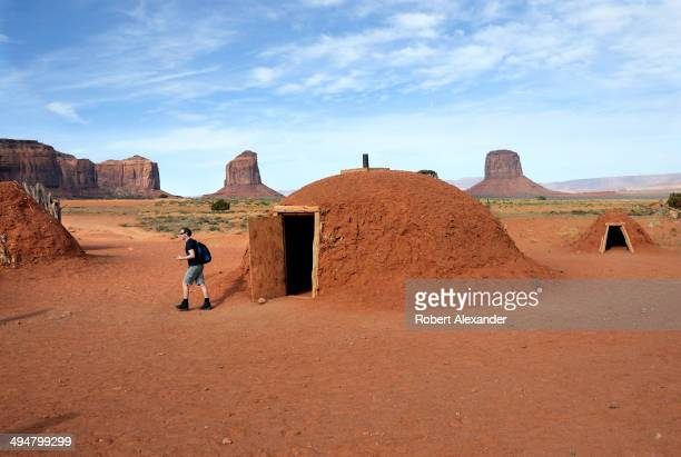 A tourist inspects a traditional Navajo home or hogan during a tour of Monument Valley Navajo Tribal Park in southeastern Utah Monument Valley a...