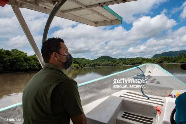 Tourist is seen on a boat in the Tempisque River, in Guanacaste, Costa Rica, on August 26, 2021. - Costa Rica has recovered in the period from...