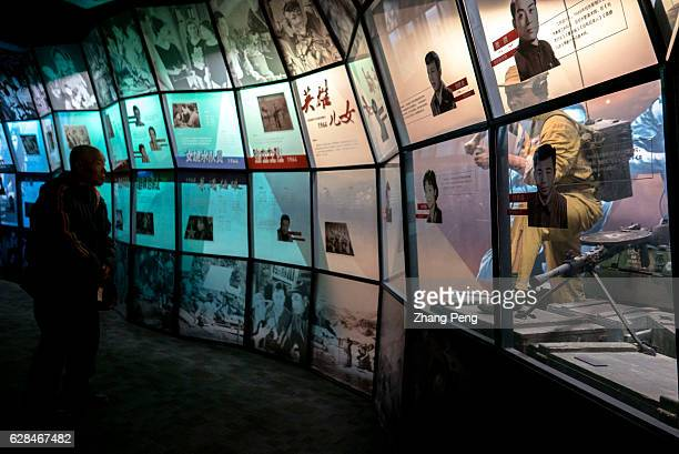 A tourist is watching the exhibition of an famous classic film 'Heroic Sons and Daughters' which was produced by Changchun Film Studio Changchun Film...