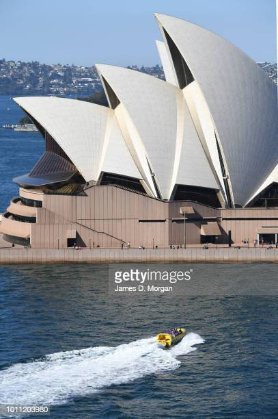 A tourist jetboat passes the Opera House in the warm winter sunshine on August 5 2018 in Sydney Australia Sydney has had 13 days of at least 20...