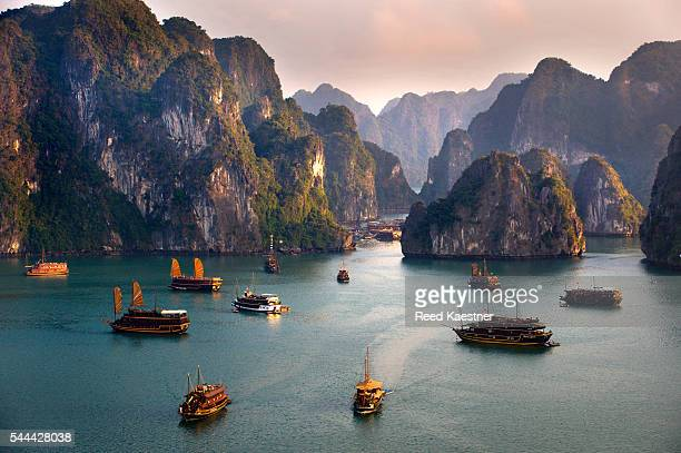 Tourist junks take visitors to see the famous limestone islands of Ha Long Bay