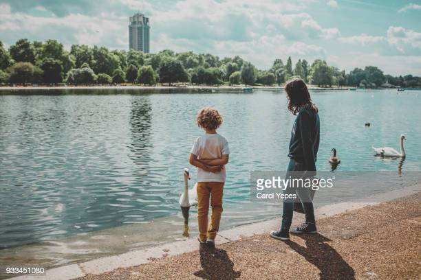tourist kids in hyde park,serpentine lake - hyde park london stock photos and pictures