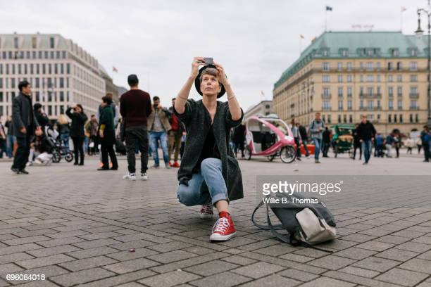 A Tourist Kneeling Down Taking Photo