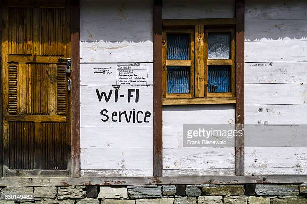 A tourist lodge with a wifi service sign at the buildings wall