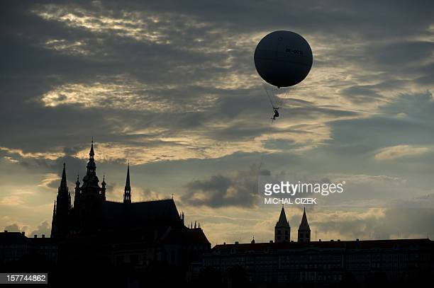 A tourist look at the Prague Castle from a balloon on July 27 2010 AFP PHOTO/MICHAL CIZEK