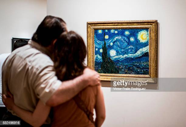 Tourist look at The Starry Night by painter Van Gogh at Museum of Modern Art on June 18 2012 in New York United States of America Photo by Victor...
