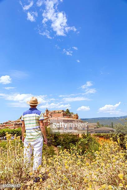 Tourist looking at french village, Provence France