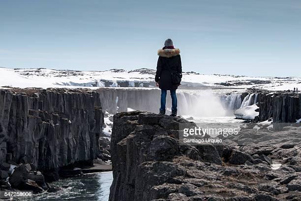 Tourist looking at Godafoss waterfall