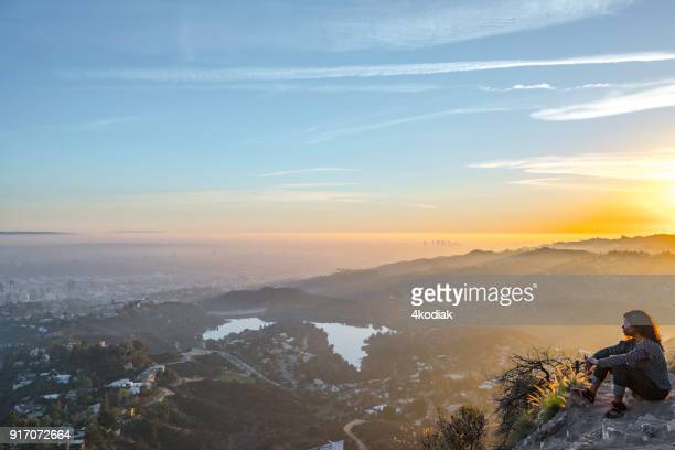 a tourist looking at hollywood and hollywood lake. - mulholland drive stock photos and pictures