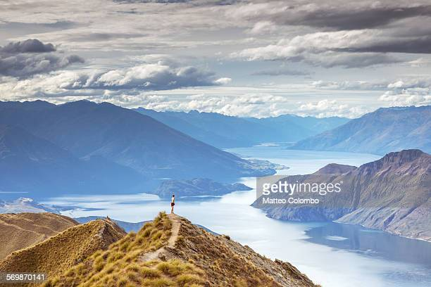 tourist looking at lake wanaka from high point - wide angle stock pictures, royalty-free photos & images