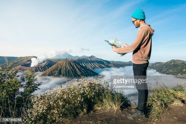 tourist looking at map - beige pants stock pictures, royalty-free photos & images