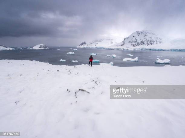 A tourist looking at the Antarctic Landscape