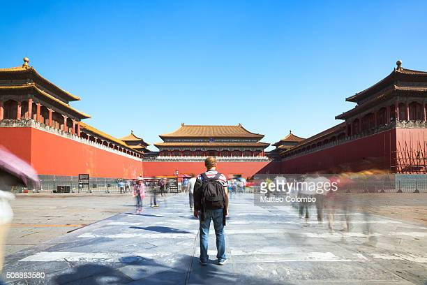 tourist looking at the forbidden city in beijing in a sunny day - beijing province stock photos and pictures