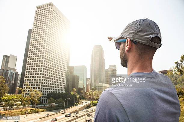 Tourist looking at the los angeles skyline