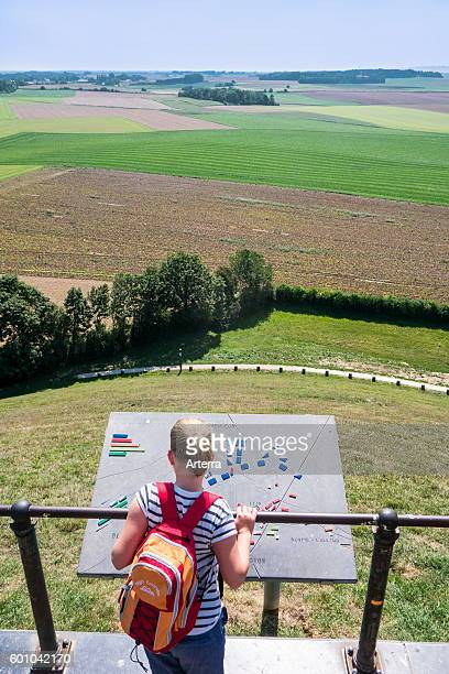 Tourist looking over the 1815 Waterloo battlefield from the Lion's Mound at Braine l'Alleud Belgium
