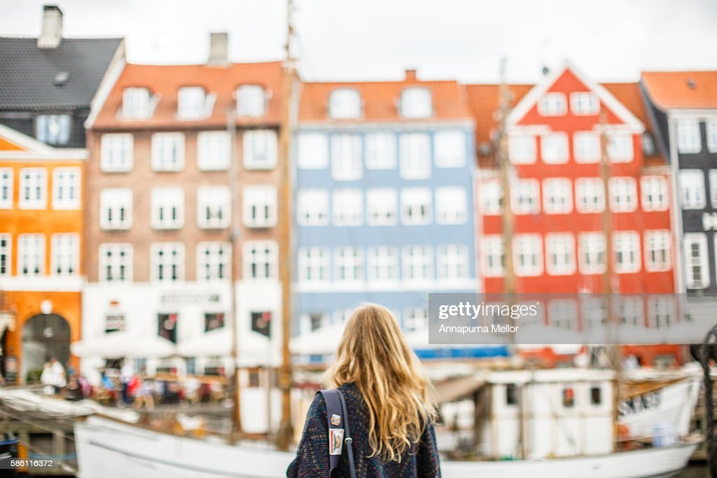 A tourist looks at a view of Nyhavn, Copenhagen, Denmark : Stock Photo