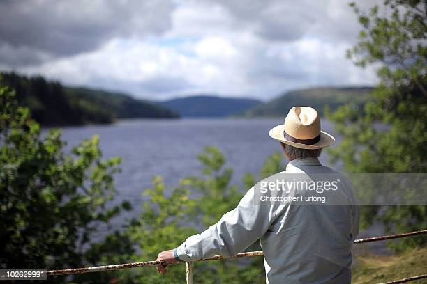 A tourist looks out over Lake Vyrnwy and it's surrounding estate which is for sale at GBP 11 million on July 5 2010in Llanwddyn Wales The sale of...