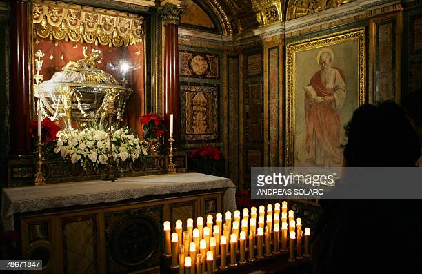 A tourist looks over the cradle said to be where Jesus was born in the Basilica of Santa Maria Maggiore in Rome 29 December 2007 According to experts...