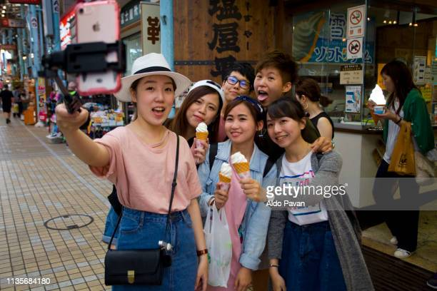 tourist making selfie in Makishi Pubblic Market, Naha, Okinawa, Japan